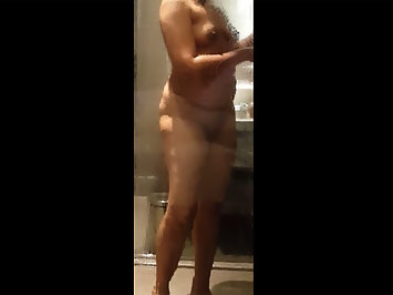Desi mature Indian housewife in shower